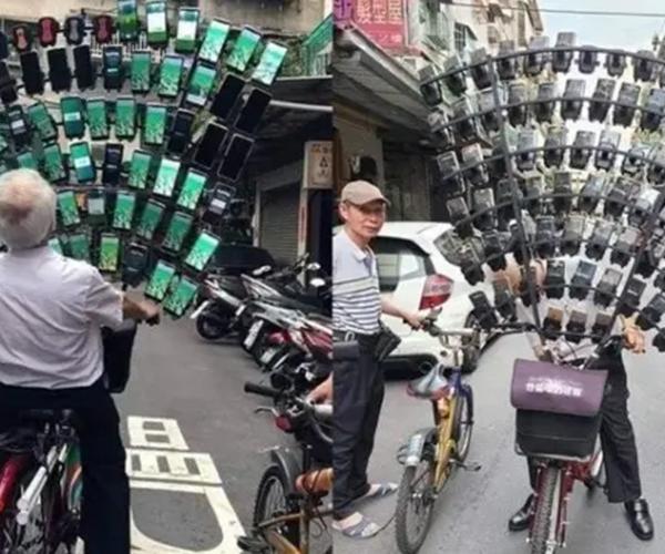 Seorang Kakek Asal Taiwan Pecandu Pokemon Go Dengan 64 Ponsel